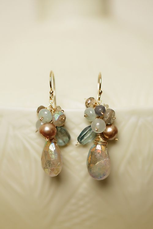These handcrafted gemstone cluster earrings feature gorgeous quartz with an aurora borealis finish and other fine gemstones and pearls. Handcrafted on gold filled wire. Gemstones including quartz, pe