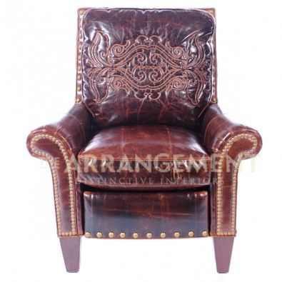 Trail's End Leather Recliner  Take distressed leather to the next level.  Graceful scrolled arms and nail head trim are the gentle details that complement the excellent embossing on the chair back. Elegant and rustic.