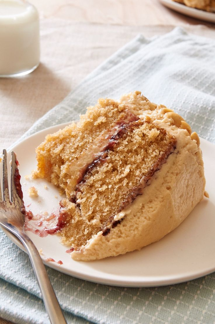For your next birthday party serve this Peanut Butter & Jelly Cake. It's just like a pb&j sandwich but with frosting. What?! | ibakeheshoots.com