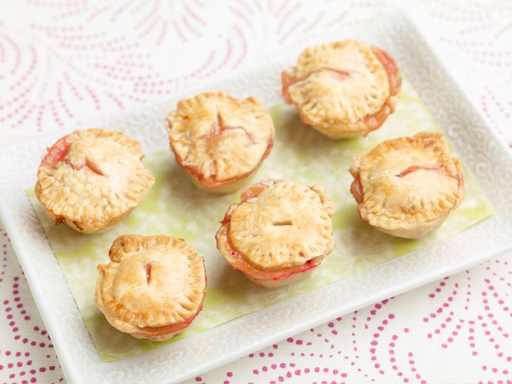 Baby Strawberry and Honey Pies : Giada De Laurentiis fills these mini pies with a strawberry, honey and orange-zest mixture that celebrates the lively flavors of spring fruit.