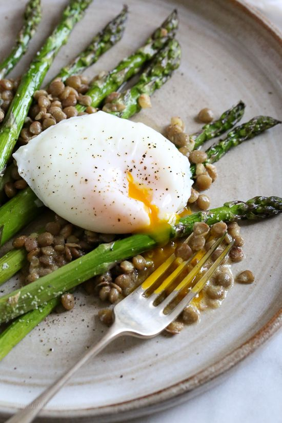 Asparagus and Green Lentils with Poached Egg is an impressive-looking brunch dish perfect for Spring. The cooked lentils are tossed in a Dijon vinaigrette. The yolk from the poached egg makes a velvety sauce over the roasted asparagus and lentils. Crisped proscuitto or bacon could also be added if you want to add some meat […] :: Food
