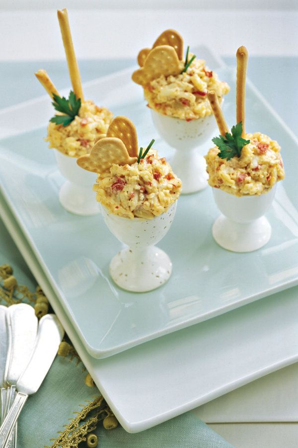 Liven up Spicy Roasted Red Bell Pepper Pimiento Cheese by serving it in eggcups (available at most import stores). Thin breadsticks and parsley sprigs, or butterfly cracker halves and chives make fun garnishes.    Recipe:Spicy Roasted Red Bell Pepper Pimiento Cheese