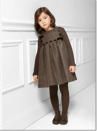 Preppy little girl style, round brush hair ends inward, and side bang. Super cute tights, Mary James and french girl dress.