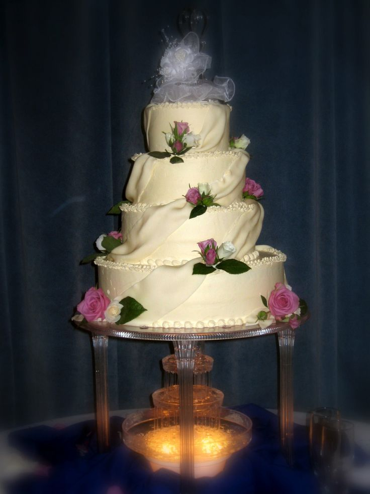 Round Wedding Cake With Pink And White Roses Fondant Drapes