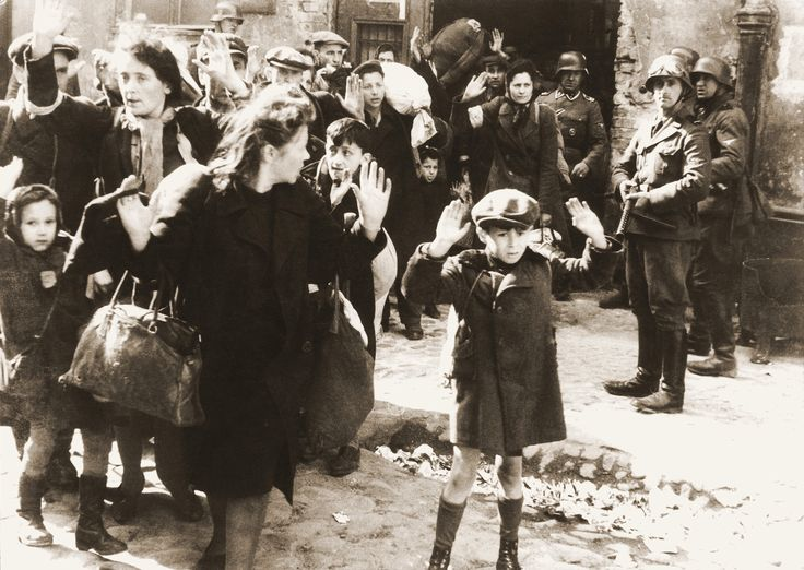 The Warsaw Ghetto Uprising is an example of Jewish resistance towards the actions and beliefs of the Holocaust. It occurred during 1943 in the Warsaw ghettos in Poland. This is a photo of Jewish citizens being taken out of their dugouts. It is a very famous photo of events during World War II.