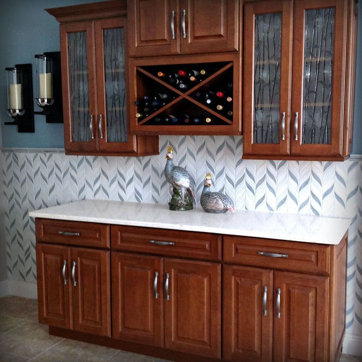 Here's a tropical take on a buffet built using #CliqStudios Lyndale-style cabinets in Cherry Cider wood finish and features our Under-Cabinet Wine Rack.
