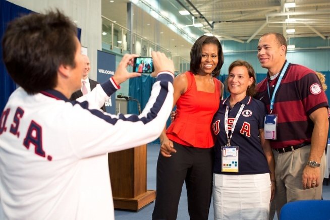 First Lady Michelle Obama with US Olympic Captains Rachel Isaacs and Wes Barnett