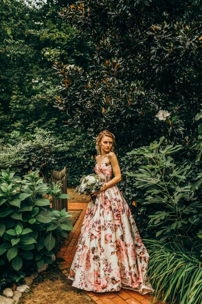 This bride's non-traditional floral gown stands out from the crowd   Image by The Markows Photography