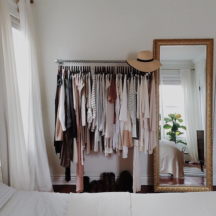 Clothing rack of pipes for more storage with gorgeous mirror on one side @Design*Sponge