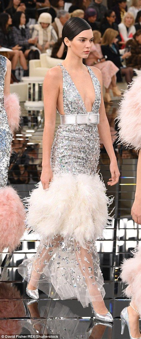 Sheer perfection: Kendall's gorgeous gown boasted an opulent, feathered hemline which was set off by a loose gauze trim embellished with glittering crystals
