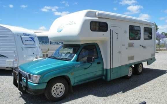 Toyota Hilux- Matilda Crystal Motorhome Year 1999 SALE NOW $39,999 Automatic.......2.7ltr...4cyl...6 wheeler.......Normal car license.....Mass: 3060kg.......GTM: 3500/4250........Bed above cab......table also folds down to a double bed......legal seating for 4.....2 in cab and 2 around table at rear......shower/toilet......gas cook-top with small oven.....microwave......tv.......r/c air conditioning.....3 way fridge.....range-hood......tow bar.....fiama roll out awning.......plenty of…
