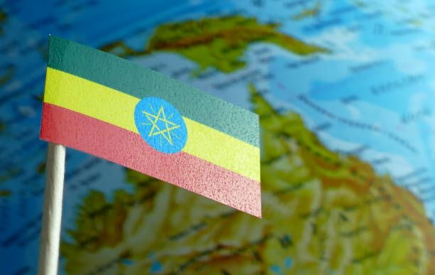 ethiopian flag with a globe map as a background macro