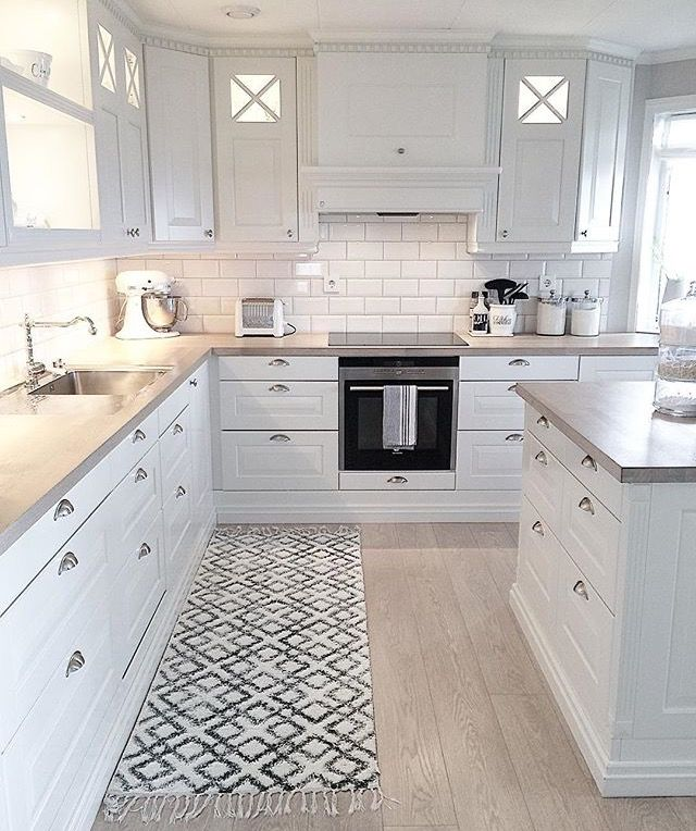 Love the subway tiles and all white. Black knobs i…