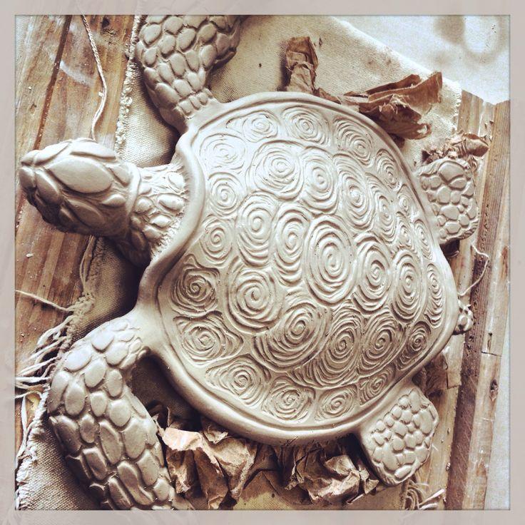 Clay sea turtle sculpture