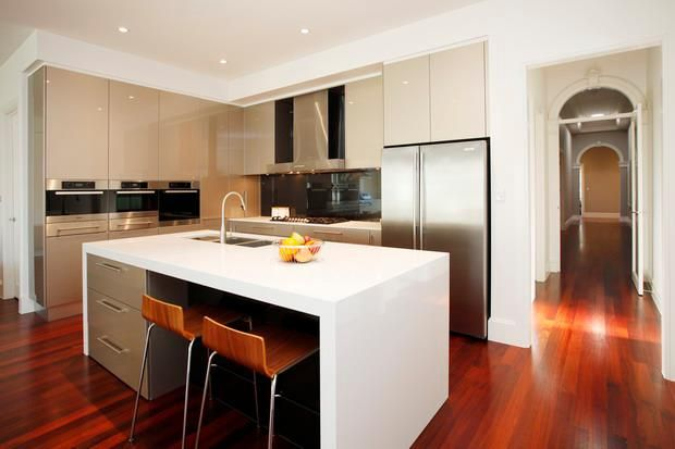 We love the clever design of this corner kitchen - so functional with lots of storage space, yet not over crowded either!
