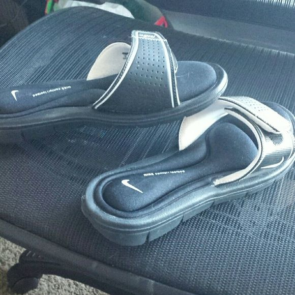 Nike slip on sandals Very padded, only worn once! Narrow, just fyi. Velcro straps for adjustment Nike Shoes Sandals