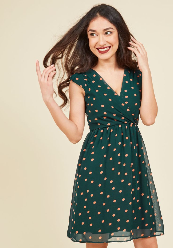 Slipping into this pine green dress is sure to put a skip in your step. Touting peach polka dots, cap sleeves, and a surplice neckline, this vintage-inspired frock - a ModCloth exclusive - is nothing short of sweet!