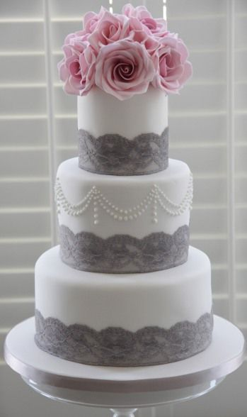White cake with grey lace accents - what a beautiful cake! Maybe if we ever renew our vows