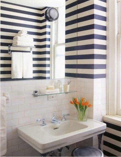 Horizontal stripes make a bath seem wider. I love the bold navy and white stripes.