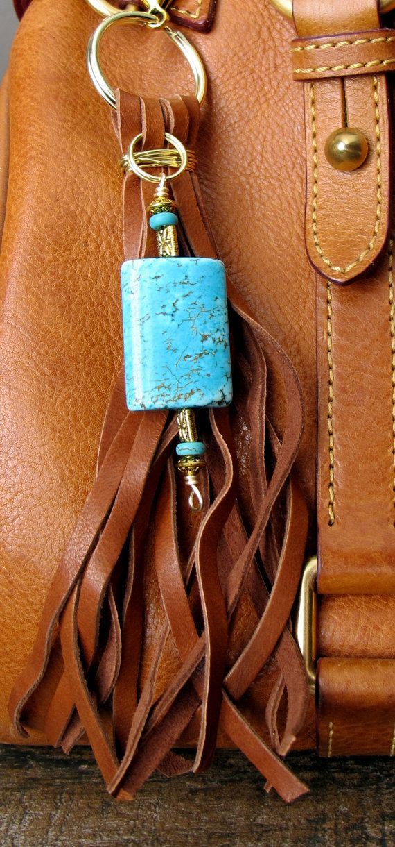 #ThePaintedCabeza ~ This handmade tassel charm can be used on your purse, backpack, zipper, wherever youd like to add some charm! Its made up of light brown deerskin suede, turquoise stone beads, and gold plated beads. Altogether, the charm is approximately 77.5 long.