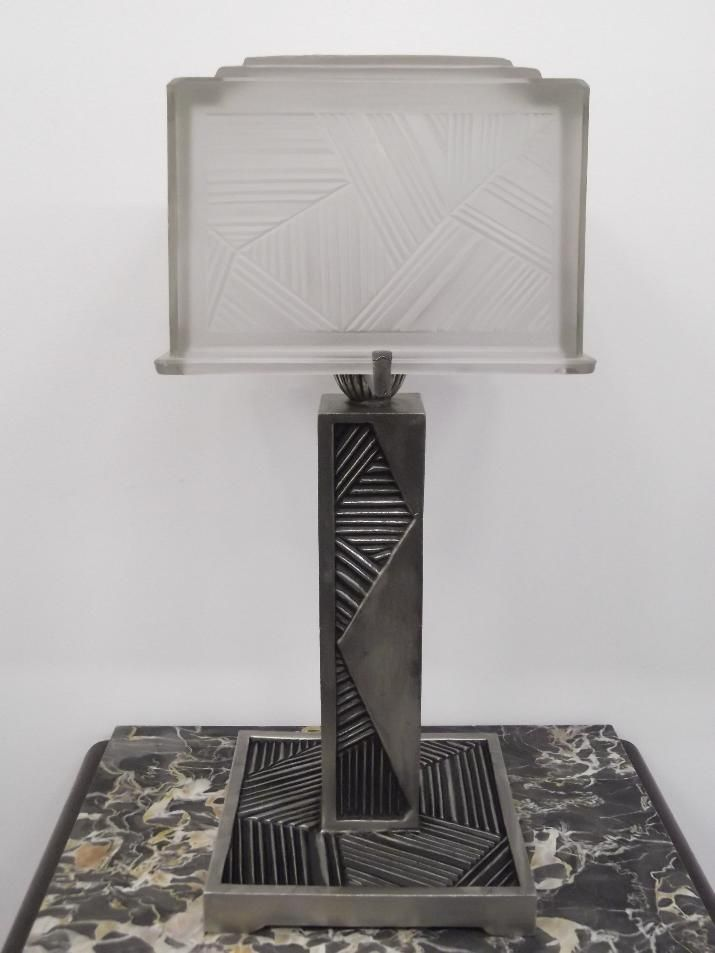 """Sabino Table Lamp - A stunning 1930s French Art Deco Square shaped Table Lamp by Marius Ernest SABINO (1878 - 1961). The shade is enhanced by typical French Art Deco geometric motif in frosted glass with polished details in great condition, modest wear commensurate with age. The shade is marked """"SABINO  4648  FRANCE"""" .  Reference #: TL8713  Measurement: Height: 19 in. (48.26 cm)   Width: 9.5 in. (24.13 cm)   Length: 9.5 in. (24.13 cm )"""