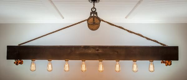 This rustic cedar beam with Edison bulbs is suspended by a barn pulley and 3/4 inch rope. The 6x6 beam is hand planed and sealed with the color of your choice to create a stunning focal point in your home.The pictured chandelier includes your choice of Edison bulbs which are dimmable! Because all of our fixtures are handcrafted, you have the ability to choose the finish, style of bulbs, and pulley, making your light uniquely yours! Our standard drop length from the ceiling is 32 inches...
