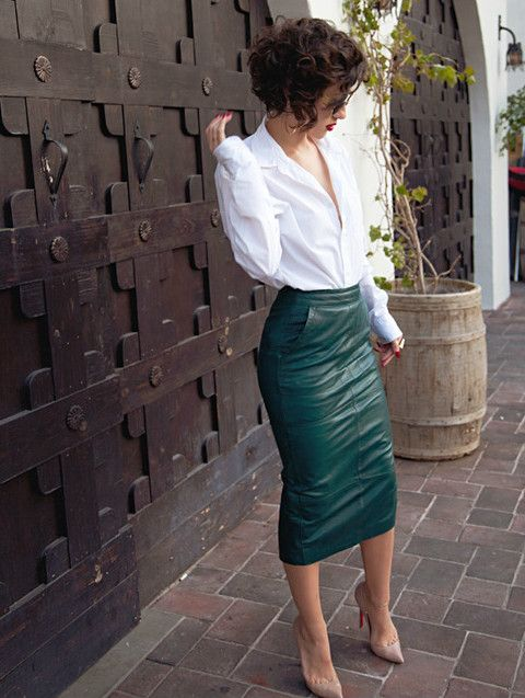 Simple & chic. Every woman needs a nice leather pencil skirt in their collection.