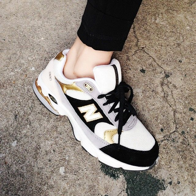 New Balance black and gold sneakers