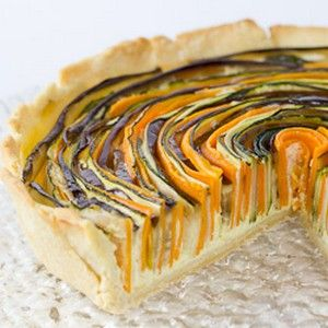 A spiral vegetarian tart, with mozzarella and sour cream.