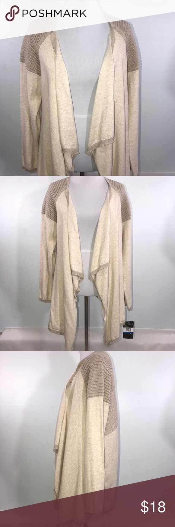 """DKNY Jeans Woman's L/S Swing Sweater XL Tan Gold DKNY Jeans long sleeve tan and gold swing sweater. Lying flat, approximate measurements are: bust 23""""; waist 25""""; hip 26""""; length 32-38"""". (C03-19).     🌼 No holes, piling or stains. Items stored in smoke free, pet free, perfume free environment. No trades or modeling. Same or next day shipping.  Save by bundling. All offers should be submitted with the offer button. DKNY Jeans Sweaters"""