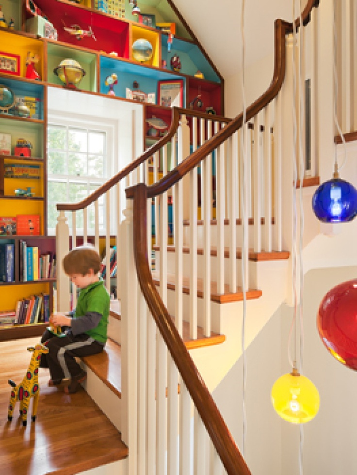 I love this - and check out the hanging lights next to the staircase.