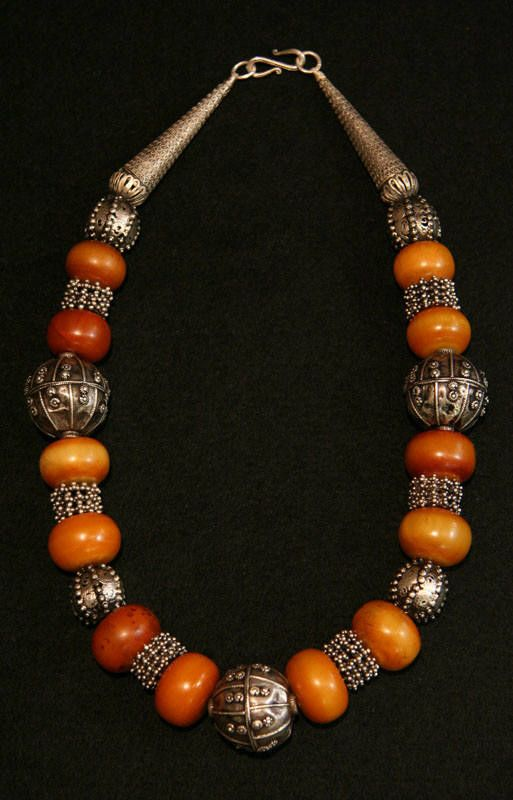Dorian Rae Collection Designs.  Old Yemen silver beads are combined with Nigerian amber (copal) beads from the African Trade.