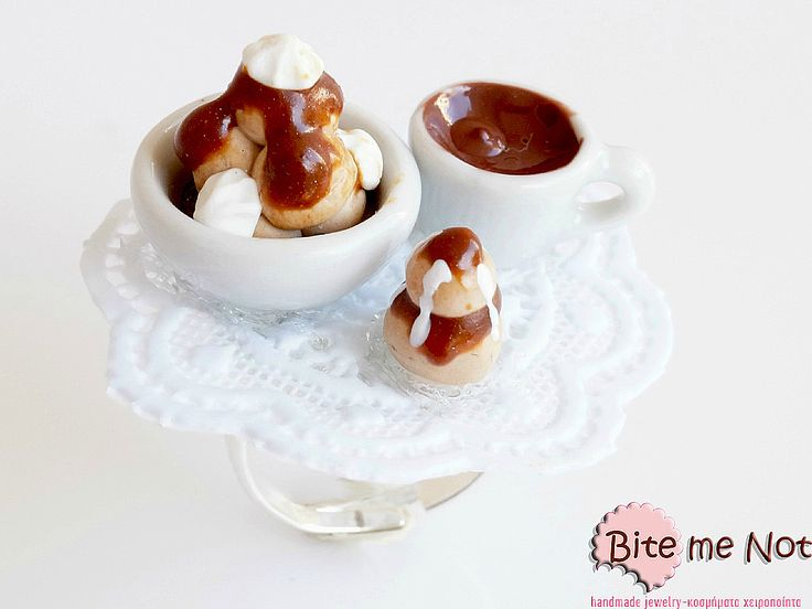 Profiterole and Coffee Ring!  -Silver plated adjustable nickel free ring -Choux pastries and coffee are nicely served on a plastic doily.Enjoy!