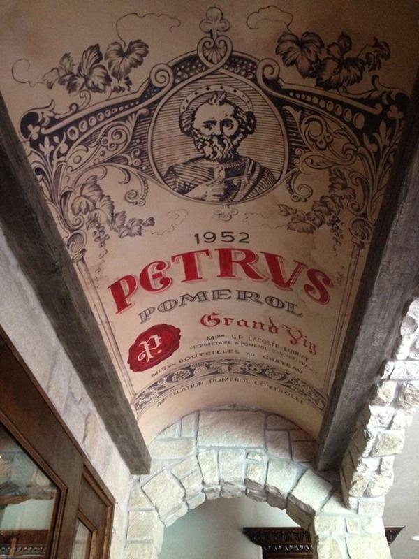 Wine cellar ceiling reproducing the label of a famous Bordeaux wine: Petrus 1952