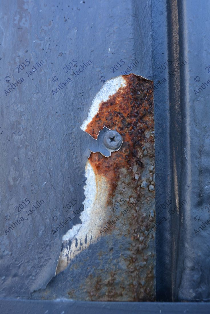 Exposed rust texture. Colour composition. Orange and blue