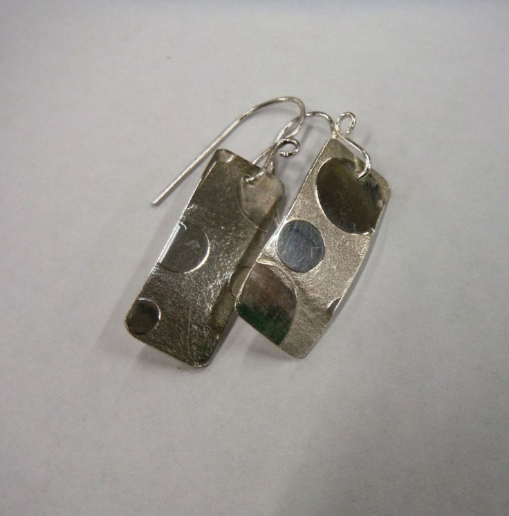 Rolling mill printed textured earring by Rita Altman