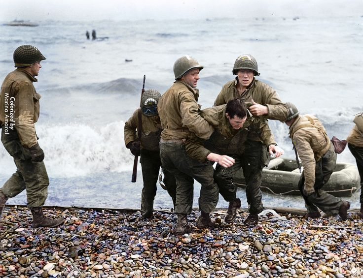 Newly colorized photos show American, British and Canadian soldiers preparing to land on the beaches of Normandy and marching through the co...