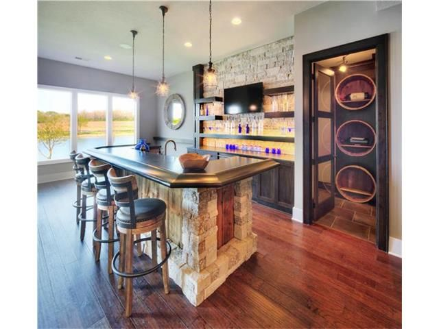 Basement Bar Connected To Enclosed Wine Cellar