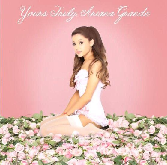 Ariana grande i could not first notice you in the pic cause you look as pretty as flowers