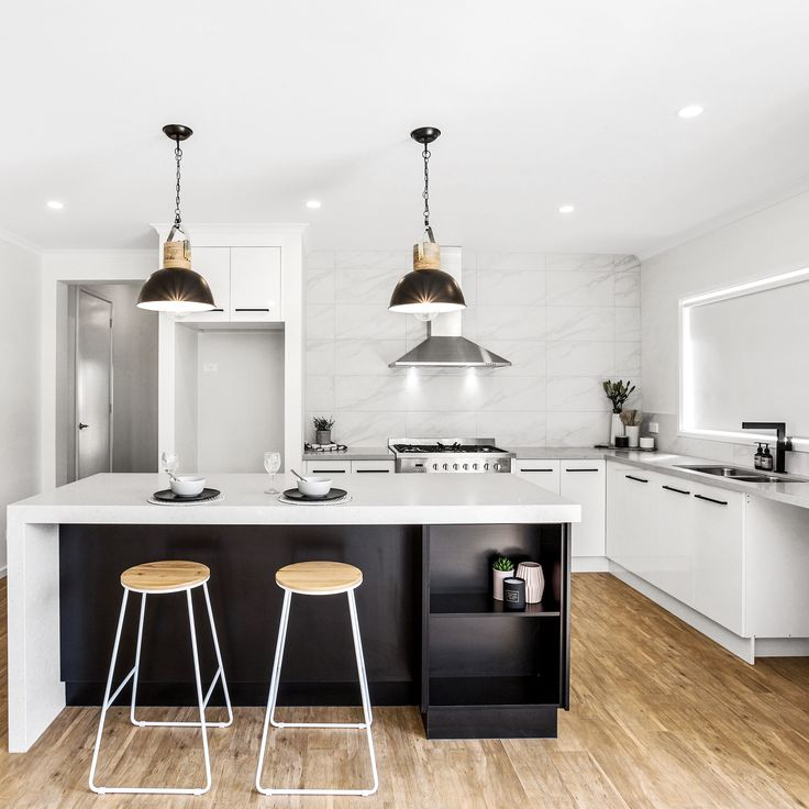 Sleek lines & bold finishes with #MeirBlack tied together with natural tones for a warm, modern aesthetic.  @novarahomes