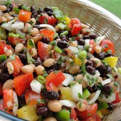 Texas Caviar  1	(14 ounce) can black-eyed peas, rinsed and drained ½	C. red bell pepper, chopped ½	C. thinly sliced green onions ½	C. refrigerated fresh salsa ½	C. chopped fresh cilantro 1	garlic clove, minced 1	Tbls. fresh lime juice 1	tsp. dried oregano