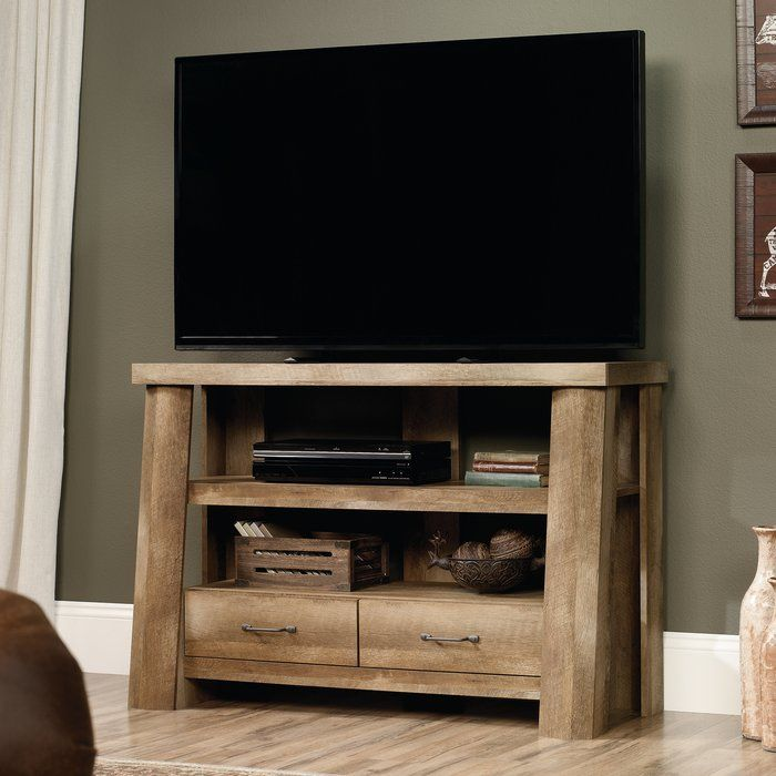 "Lend a touch of rustic appeal to your space with this charming media console, the perfect accent for any lodge-worthy ensemble. The trestle-inspired base design and craftsman oak finish give this piece its cabin-inspired style, while the two open shelves and two spacious drawers provide essential functionality. It can hold a 47"" TV weighing up to 70 lbs. Try setting it in your living room for an ideal spot to rest your flat screen, then fill the open drawers with media accessories and top…"