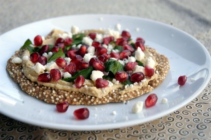 Pomegranate, feta and hummus over quinoa flatbread IN So Hungry I ...