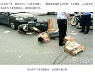 Man on motorbike crashes, lies in road and plays with phone Technically Incorrect: In China a man appears so obsessed with his phone that he clutches onto it and plays video games while lying in the road.
