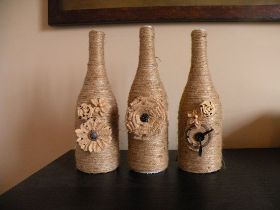 Jute WINE BOTTLES with burlap flowers by Irishfitz on Etsy