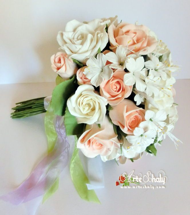 White roses and salmon with jasmine and rose leaves to a bridal bouquet with very soft colors. Handmade with polymer clay, air dried and cold porcelain request.