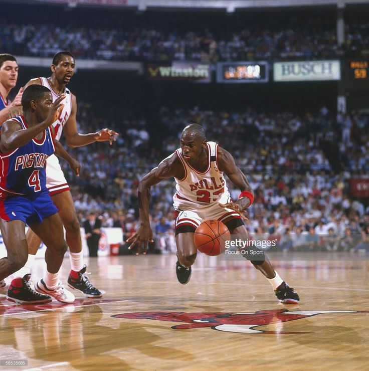 Michael Jordan #23 dribbles towards the net against Joe Dumars #4 of the Detroit Pistons during an NBA playoff game at the Chicago Stadium circa 1989 in Chicago, Illinois.