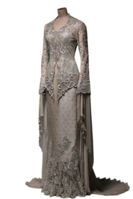 Modern Kebaya with lace and songket. Designed by Bernand Chandran. -- Could do without the super long floaty arms. Imagine eating raya food with that shit in the way hahahahaha