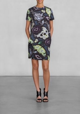 Knee-length and short sleeved dress with an intriguing oily-looking print.