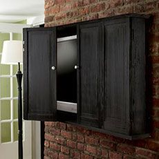 buid a tv cabinet for a flat screen tv to keep that conspicuous tv from taking over your living space when its not in use